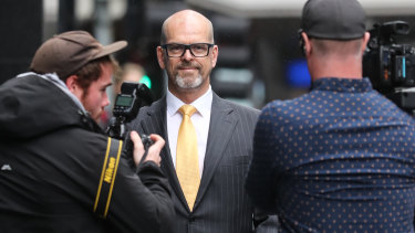 Former police commissioner Simon Overland arrives at the royal commission in December.