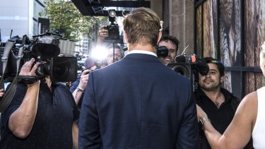Jack de Belin leaves Downing Centre Local and District Court.