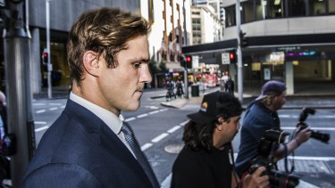 Jack de Belin leaves Downing Centre Courthouse earlier this month.