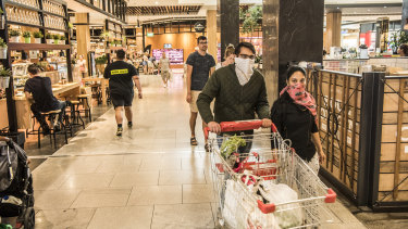Shoppers at the Macquarie Centre take their own precautions to avoid the spread of coronavirus.