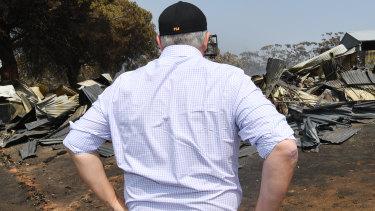 Prime Minister Scott Morrison visits a fire-damaged property on Kangaroo Island.