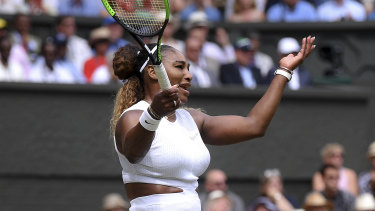 Serena Williams gestures after losing a point.