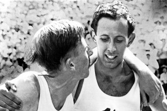 John Landy (right) and Dr Roger Bannister after they finished in the mile run of British Empire Games, in Vancouver.