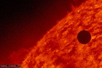 Scientists say they have found a potential sign of life high in the atmosphere above Venus.