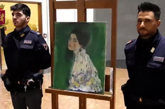 Italian police guard the Klimt after it was discovered in the gallery's wall.