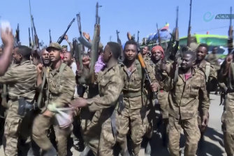 """Ethiopian military celebrate near the border of the Tigray region after PM Abiy Ahmed ordered a """"final and crucial"""" military operation against the region's leadership."""