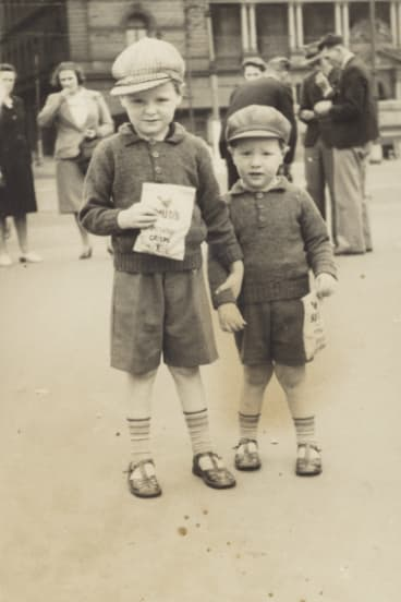 Brothers Frank and Pat Doughty at Circular Quay in 1943. Their mother sent the image to her husband who was in the Royal Australian Navy in World War II. The brothers are holding potato crisps, Spuds.