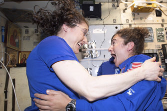 Christina Koch and Jessica Meir greet each other on the International Space Station.