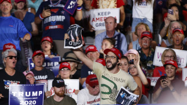 A protester calls out as President Donald Trump speaks at a campaign rally at Williams Arena in Greenville, N.C..