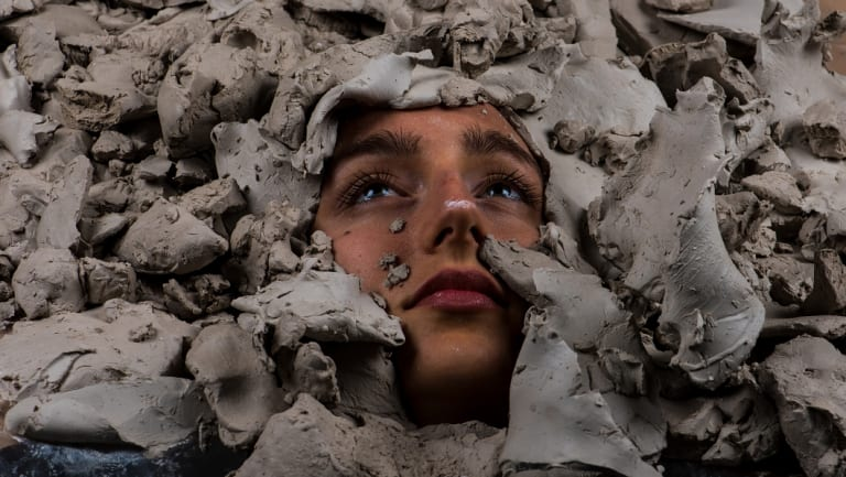 Claire Lambe's Untitled film still (Emily in clay), 2018, C type print.