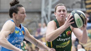 Stars aligned: Dandenongs' Sara Blicavs breaks past Canberra's Kelsey Griuffin.