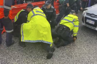 One protester caught his leg under a car during the strike.