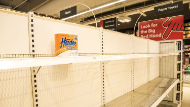 Empty toilet paper shelves at Coles.