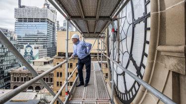 Nice view: fourth-generation stonemason Rick Timperi on scaffolding next to the GPO clocktower.