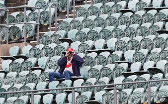 """Packed stadiums are suddenly a thing of the past, as Australians practice """"social distancing"""" to stop the spread of coronavirus."""