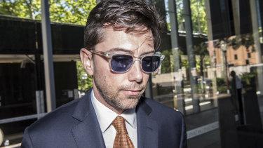 AFR columnist Joe Aston leaving the Federal Court on Monday.