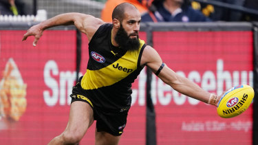 Solid defence: Bachar Houli keeps the ball inside the boundary line for the Tigers.