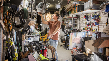 Joel Adler in his parents' garage, which is now his studio.