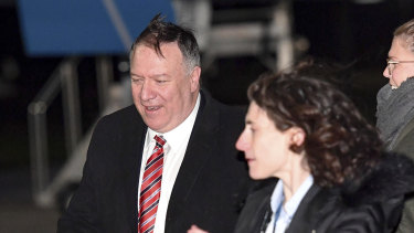 Not happy: US Secretary of State Mike Pompeo, left, after his plane arrived in London.