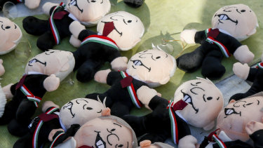 Miniature dolls depicting Mexico's newly sworn-in President Andres Manuel Lopez Obrador are displayed for sale at the Zocalo, in Mexico City, on Saturday.