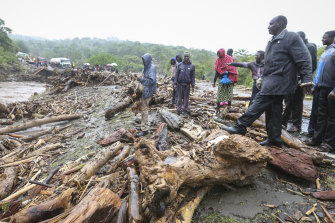 Floodwaters surge along the road from Kapenguria, in western Kenya, near where dozens of people have been killed in mudslides.