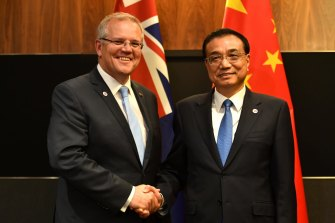 Scott Morrison, pictured with Chinese Premier Li Keqiang in 2018, is yet to visit China since becoming Prime Minister.