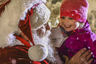 Hannah Kaleta, 4, of Florida, meets Santa Clause during the annual tree lighting in Beaver Creek, Colorado.