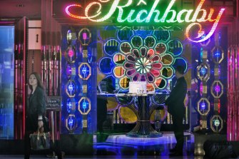 A young woman with a Louis Vuitton handback leaves 'Richbaby', a nightclub close to the hip Xintiandi shopping area.