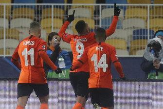 Shakhtar's Dentinho (centre) celebrates after scoring his side's opener against Real Madrid.