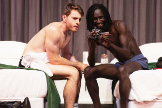 Jason (Ben Chapple) and Ade (Deng Deng) pass the hours in their motel room.