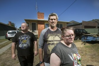 Peter Arthur, Ronald Lyons and Christine Lyons at their home in Kangaroo Flat in the days after Samantha Kelly went missing. She'd been bludgeoned to death in a bungalow at the rear of the property.