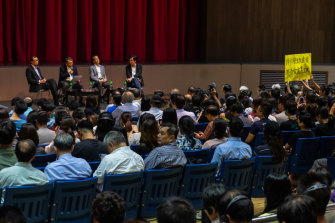 Students hold a banner as vice-chancellor Rocky Tuan Sung-Chi holds an open meeting with students of Hong Kong Chinese University earlier this month.