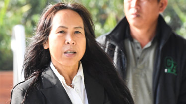 Mr Mokmool's mother Supaporn Chomphoo arrives at the inquest in May.