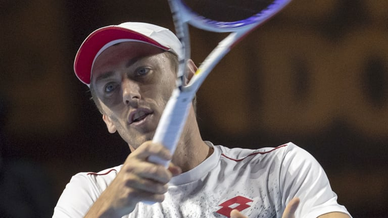 John Millman has been knocked out of the Swiss Indoors in straight sets.