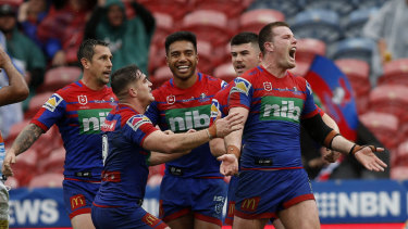 Lachlan Fitzgibbon celebrates a try in Newcastle's rout of the Titans.