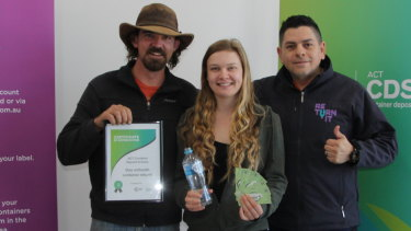 Jorge Rivera from Return.It (right), with Emily Scott and James Cottee, who deposited the one millionth container to Canberra's container deposit scheme