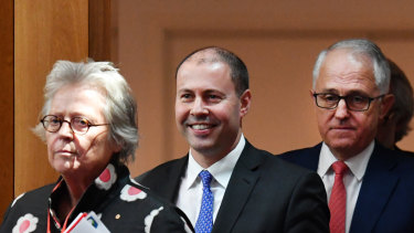 Kerry Schott, chair of the Energy Security Board, with Josh Frydenberg (middle), the environment and energy minister, and Prime Minister Malcolm Turnbull.