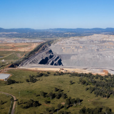 The Mount Pleasant mine, far left, and Bengalla mine, right, with the town of Muswellbrook in the distance.