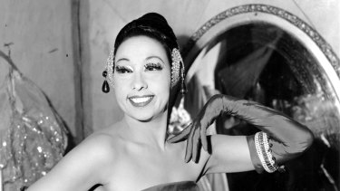 Josephine Baker poses in her dressing room at the Strand Theater in New York City in 1961.