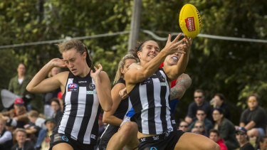 Collingwood players desperately try to contain an inform Melbourne at Victoria Park.