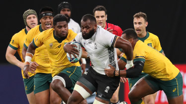 Raw power: Fiji's Peceli Yato tries to split the Wallabies' defence.