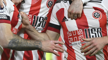 Sheffield United players celebrate the winning goal against Newcastle United in January this year. Their sponsor is now in liquidation.