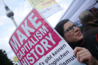 A protester holds a poster during a trade union demonstration against budget cuts, in Berlin.