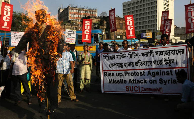A protest in India against the missile strikes in Syria.