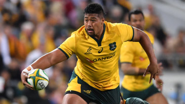 Inspired by family: Folau Faingaa escapes the clutches of a Springboks defender.