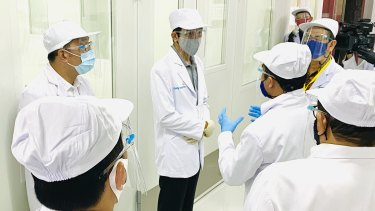 Will it work? Indonesian President Joko Widodo, centre, on Tuesday at the site of phase three clinical trial for the SinoVac vaccine.