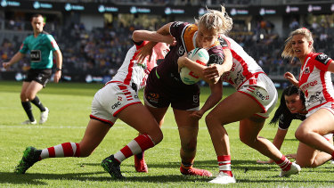Meg Ward busts through to score for the Broncos in their NRLW opener against the Dragons.