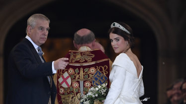 Britain's Princess Eugenie, accompanied by her father Prince Andrew, arrives for her wedding ceremony to Jack Brooksbank.
