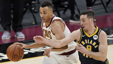 Cleveland's Dante Exum drives against Indiana's T.J. McConnell.