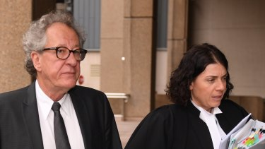Geoffrey Rush and barrister Sue Chrysanthou arrive at the Federal Court on Wednesday.